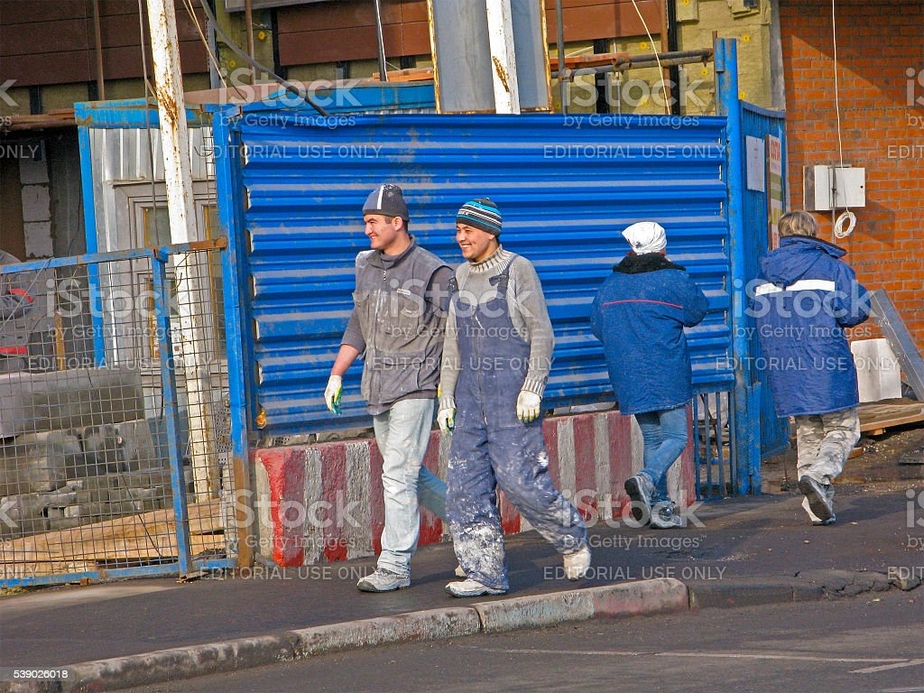 Migrants working in construction stock photo