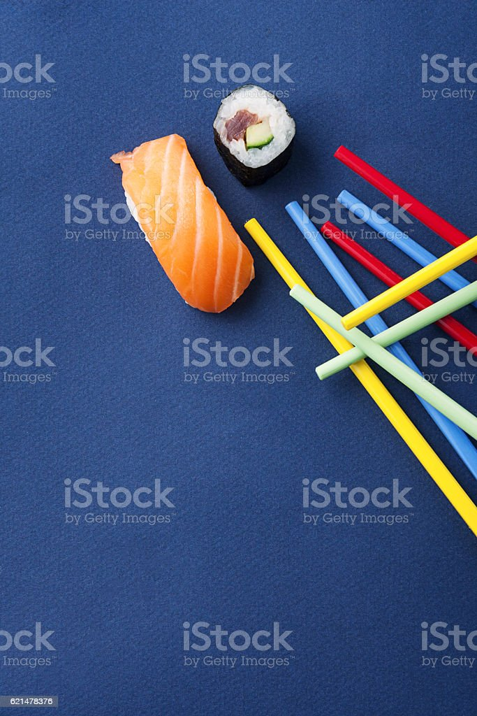 mikado with sushi and chopsticks colors stock photo