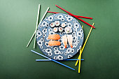 mikado with sushi and chopsticks colors