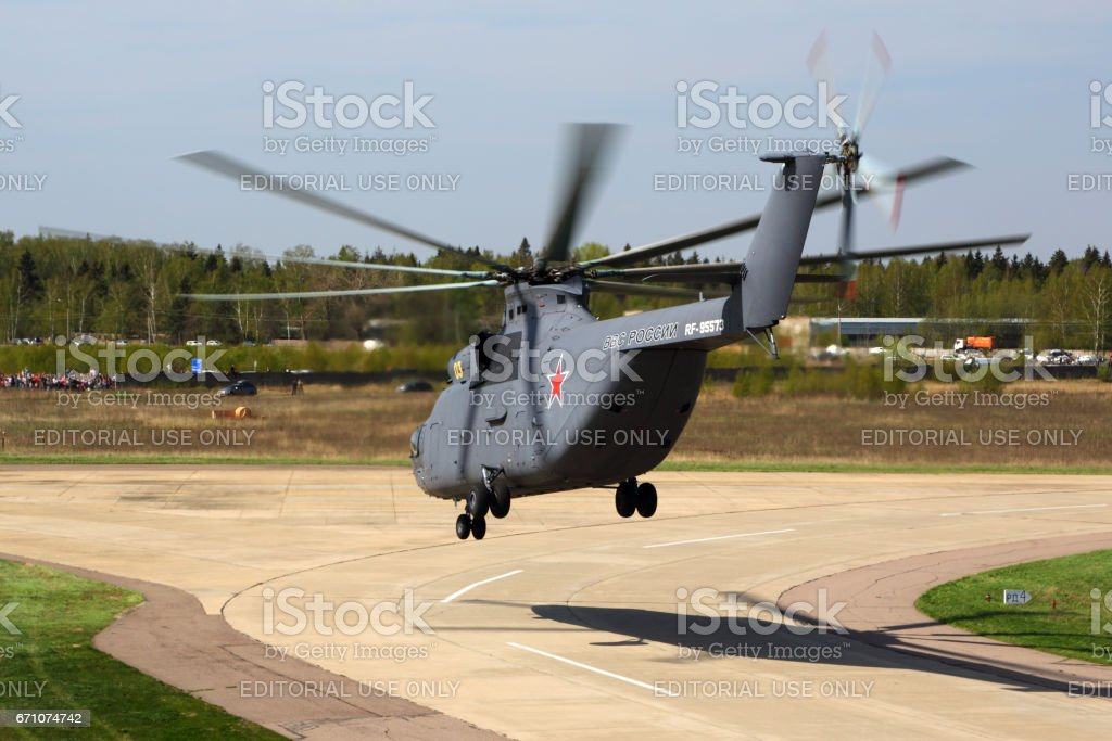 KUBINKA, MOSCOW REGION, RUSSIA - MAY 9, 2015: Mil Mi-26 RF-95573 helicopter of russian air force pictured departing Kubinka air force base on a victory day. stock photo