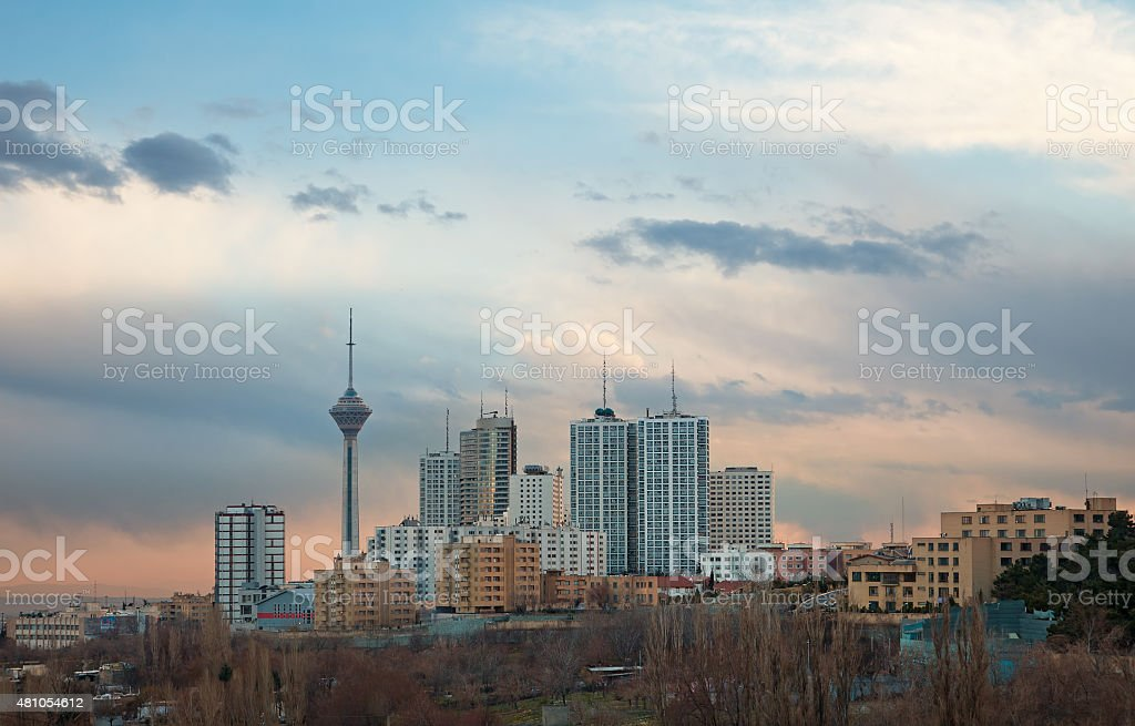 Milad Tower among High Rise Building in Skyline of Tehran stock photo