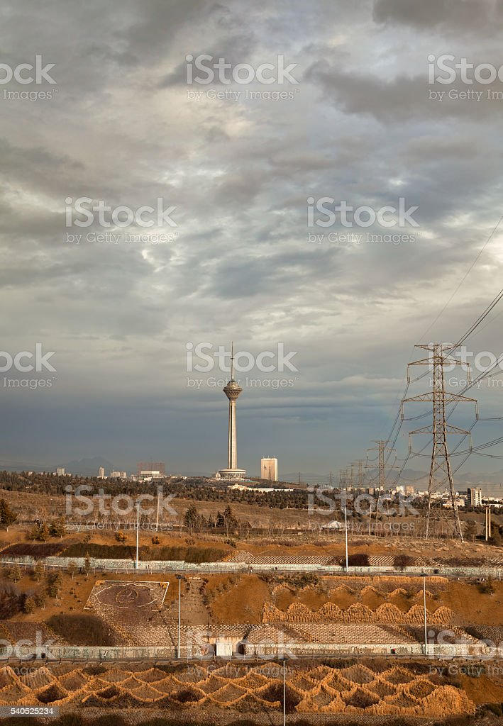 Milad Tower and Power Lines Against Overcast Sky of Tehran stock photo