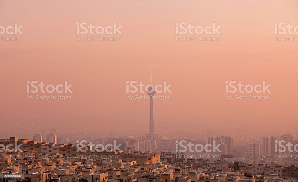 Milad Tower in the Skyline of Tehran at Pink Sunset stock photo