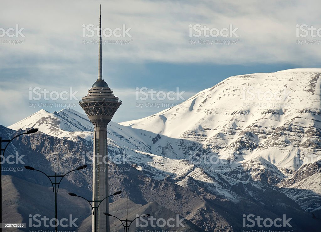 Milad Tower of Tehran Front of Snow Covered Alborz Mountains stock photo