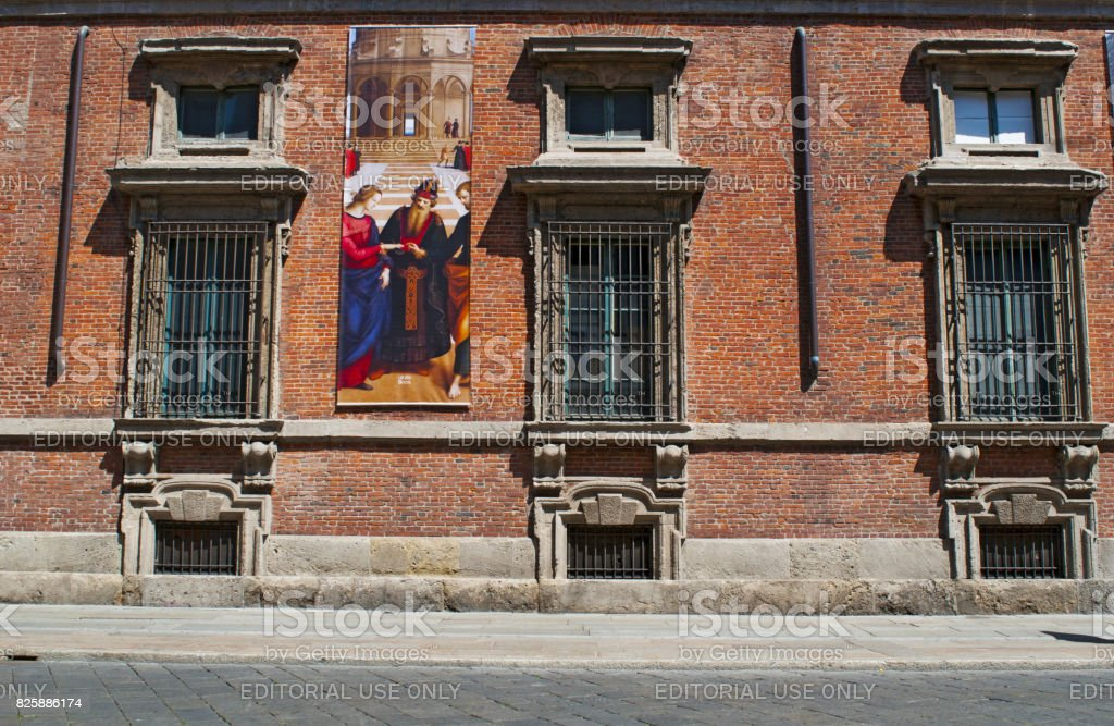 Milan: a poster of The Marriage of the Virgin, an oil painting by Raphael, on the exterior of Palazzo Brera, palace housing the Pinacoteca di Brera stock photo