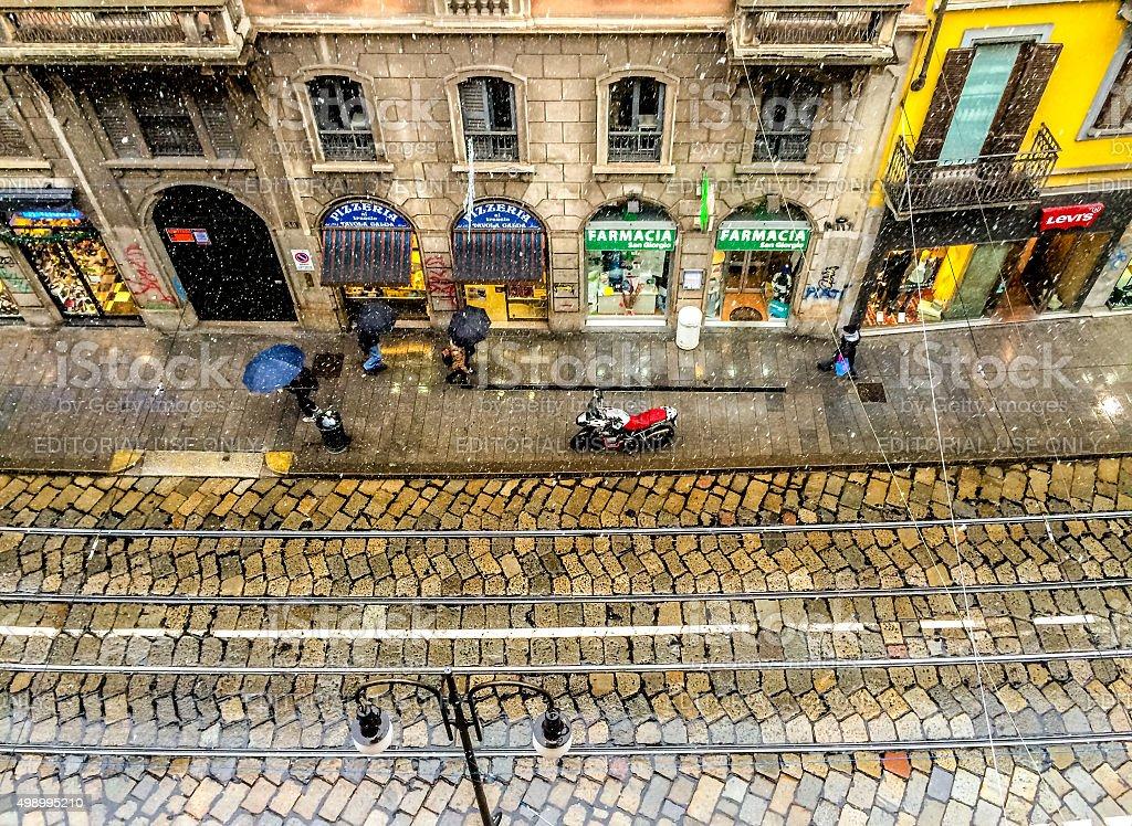 Milan street under light snow stock photo