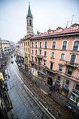 Milan street under light snow