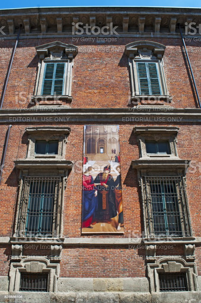 Milan: the exterior of Palazzo Brera, palace housing the Pinacoteca di Brera, main public gallery for paintings in Milan, with a poster of The Marriage of the Virgin, an oil painting by Raphael stock photo