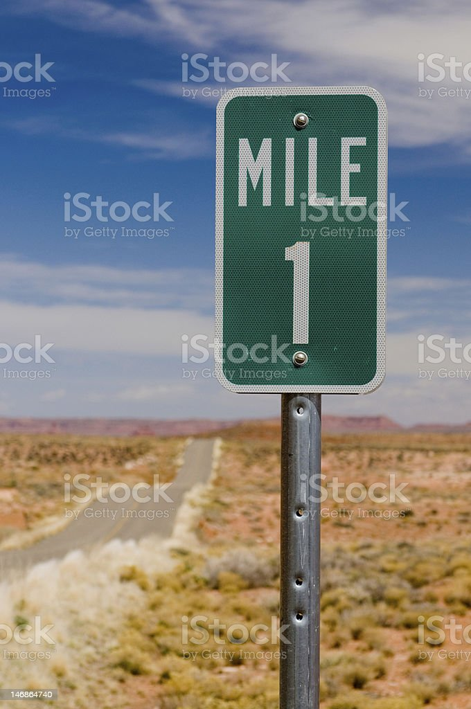 Mile 1 one marker on desert highway vertical royalty-free stock photo