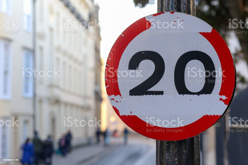 20 miles per hour mph speed limit damaged road sign stock photo