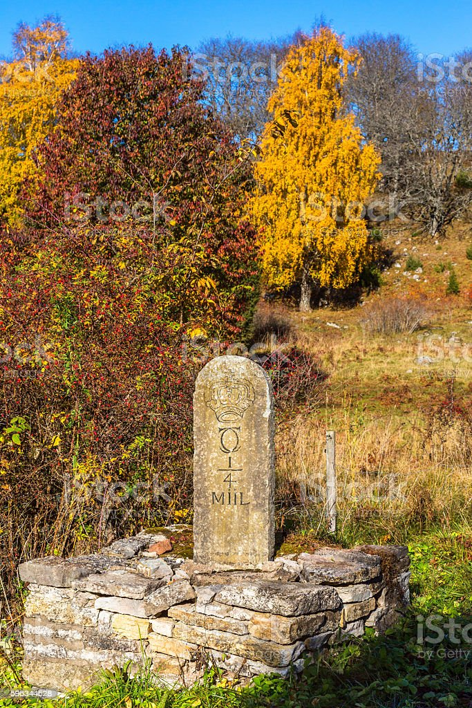 Milestone in a pasture in the autumn stock photo