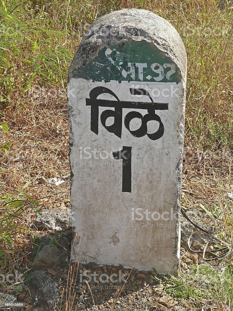 Milestone written in Regional language, Marathi at Roadside royalty-free stock photo