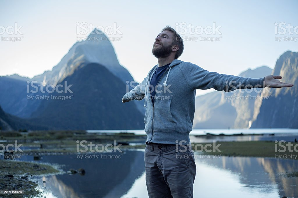 Milford Sound: Young man enjoying nature stock photo
