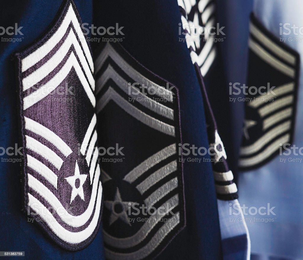 Military Air Force dress uniforms in closet stock photo