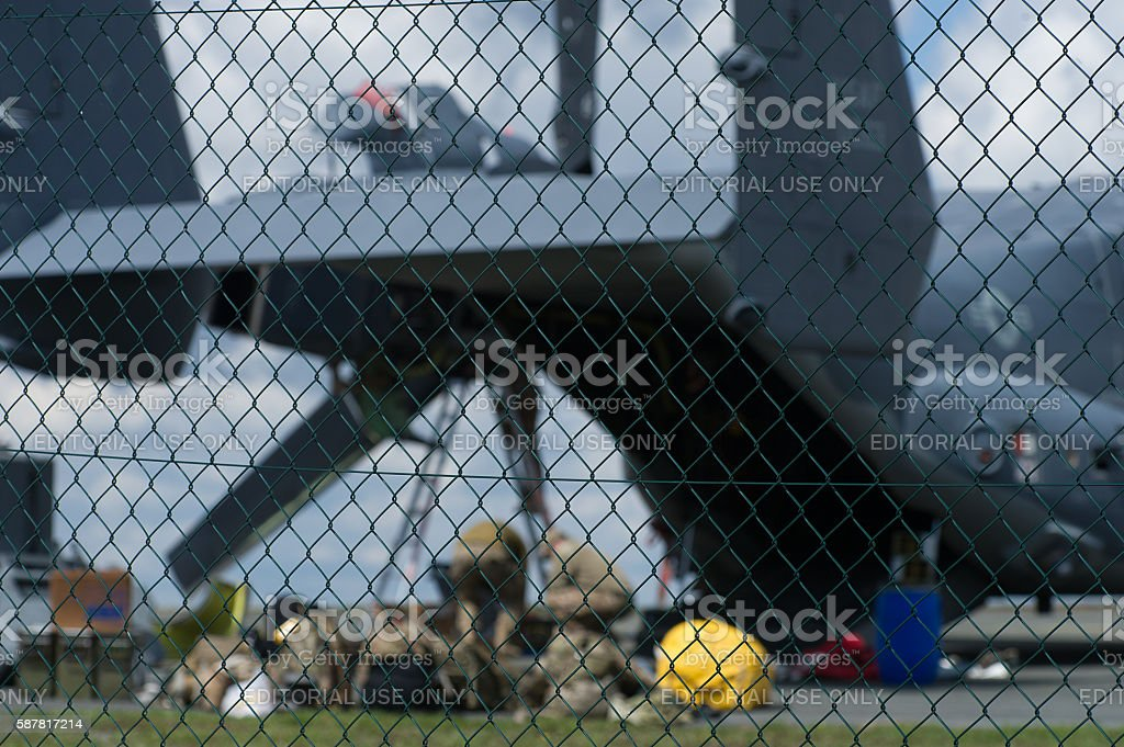 Military Aircraft behind fence stock photo