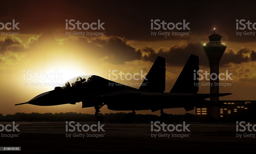 Military Aircraft on airfield ready to take off stock photo
