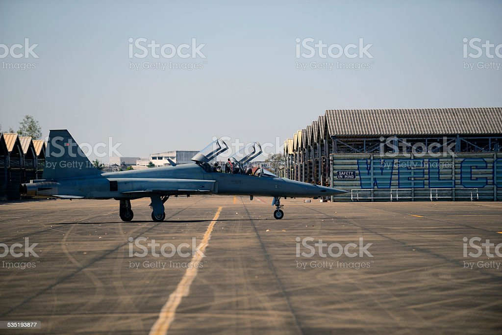 F5 military aircraft parked in the airport stock photo