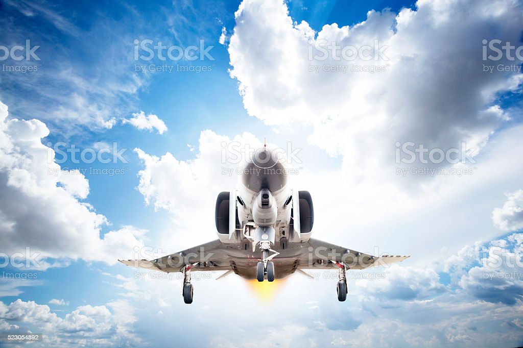 Military airplane flying stock photo