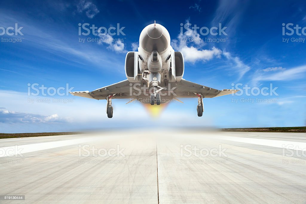 military airplane take off on airport stock photo