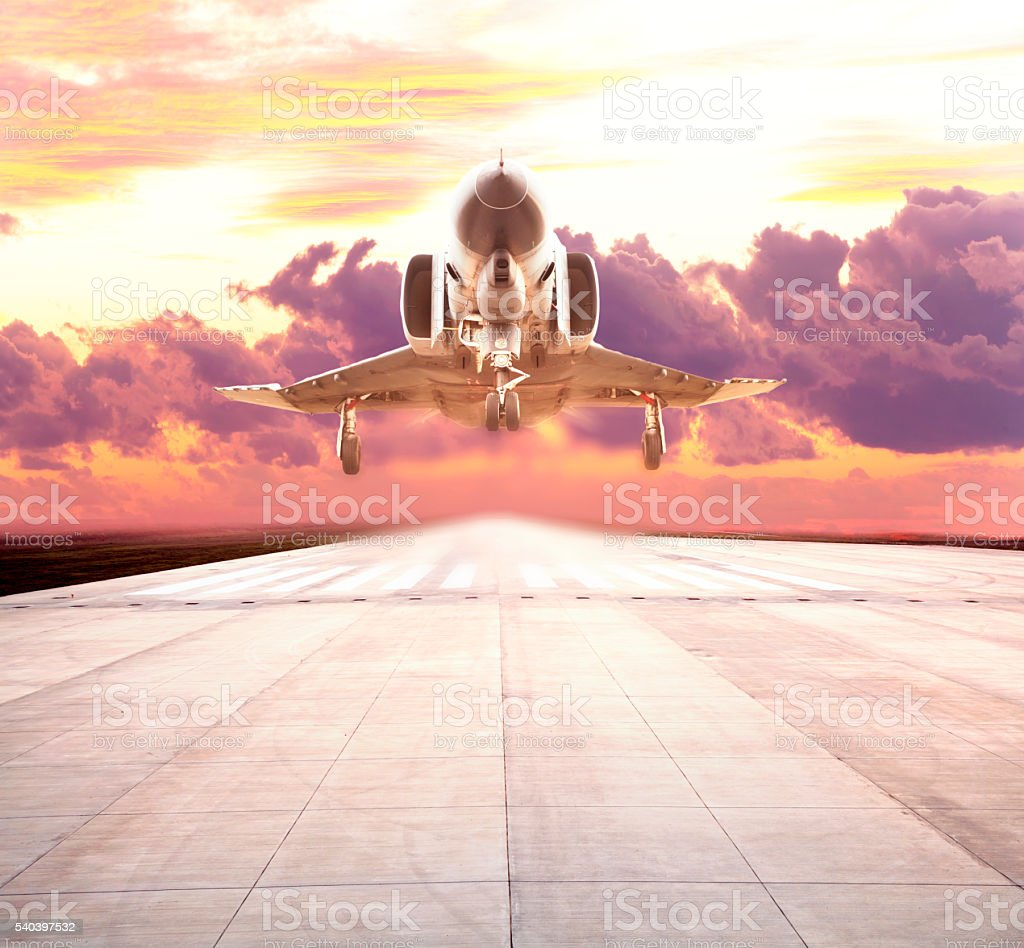 Military airplane take off on sunset stock photo