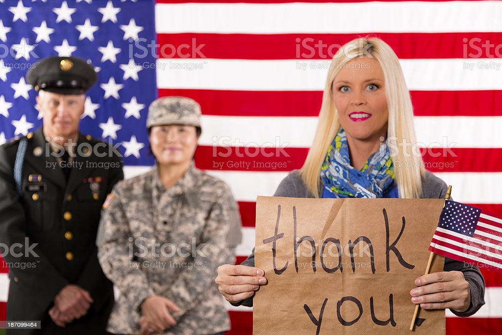 Military:  American woman shows support for local veterans. stock photo