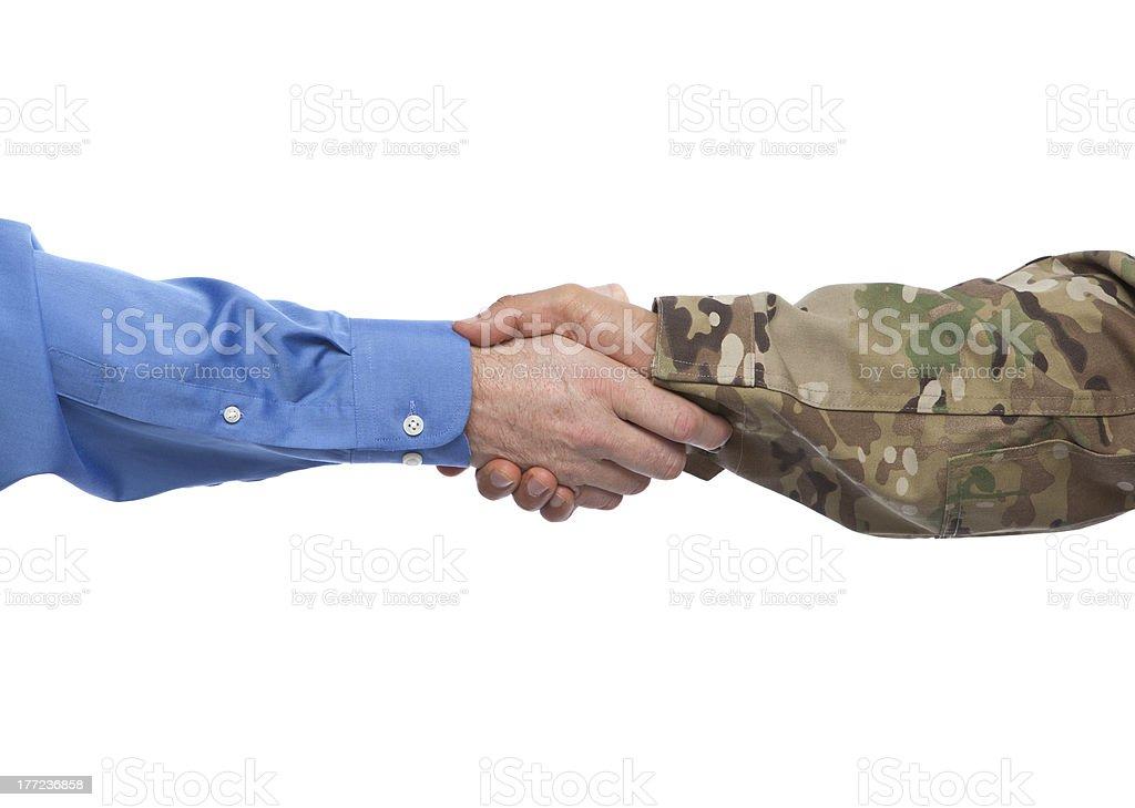 Military and Businessman Handshake stock photo