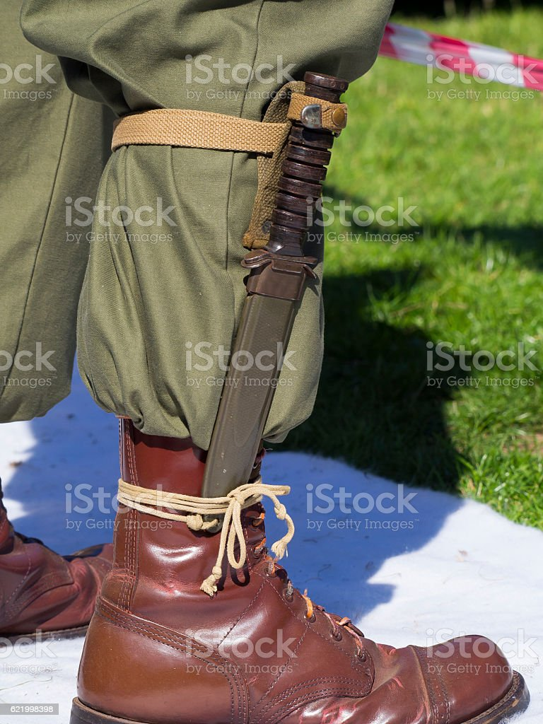 Military Army mans boot with Bayonet attached stock photo