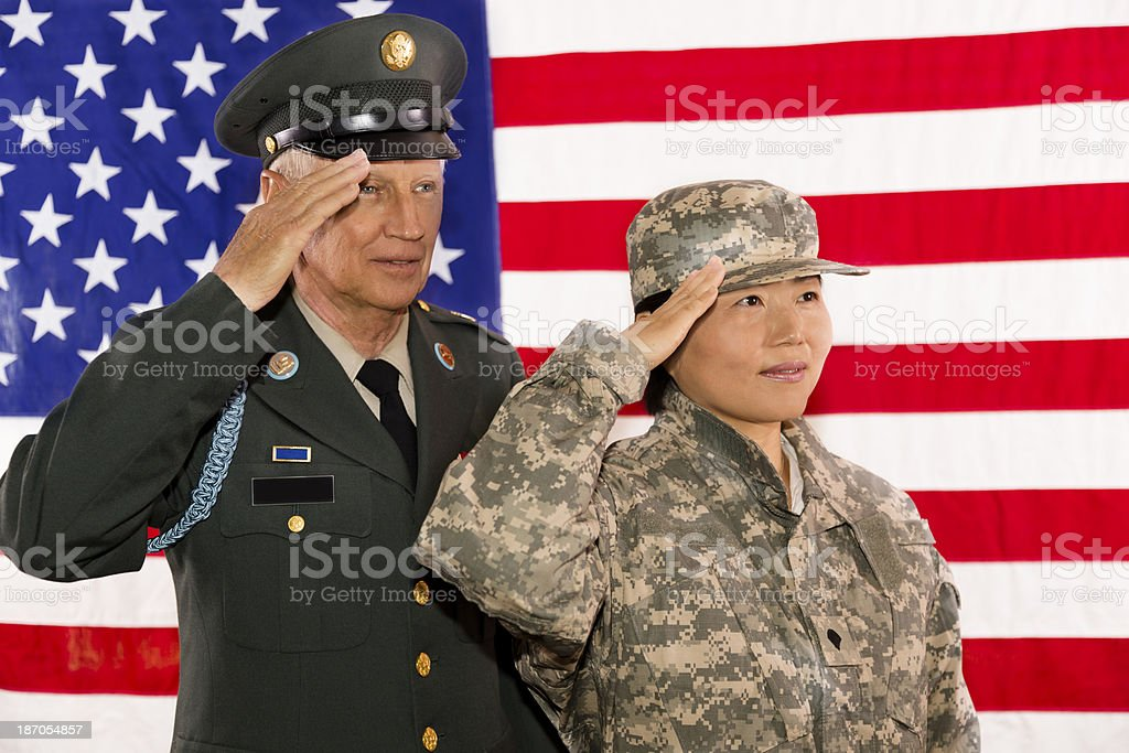 Military.  Army officer, soldier salute the American flag. stock photo