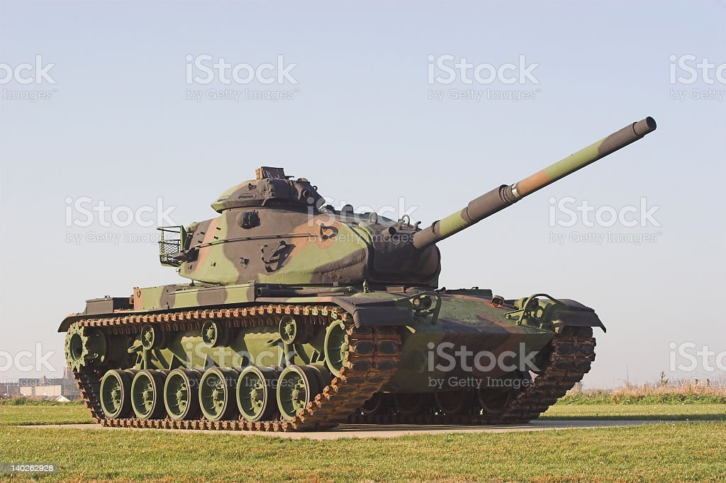 Military army tank in camouflaged colors stock photo