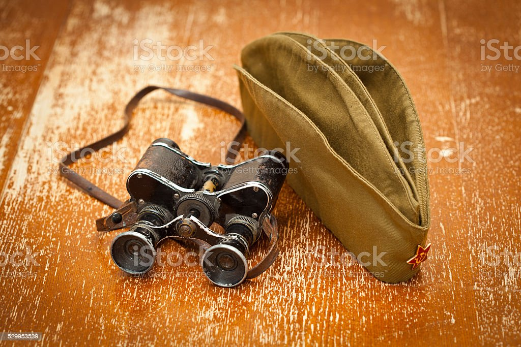 Military binoculars, forage cap with a red star stock photo