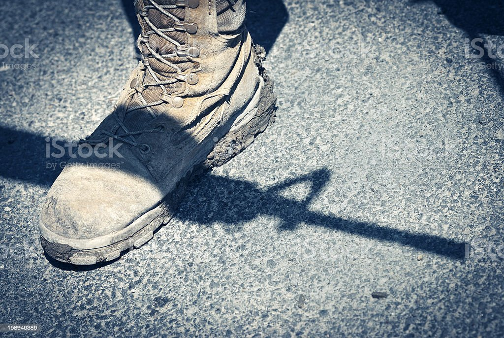 Military Boot with Rifle Shadow, Symbol of War royalty-free stock photo