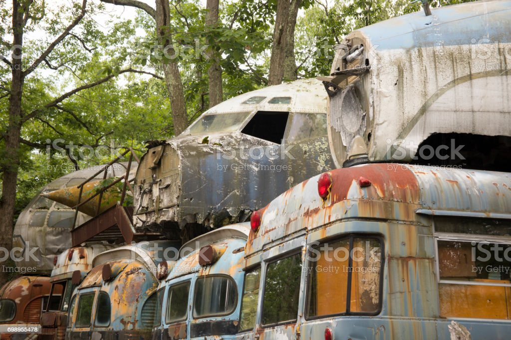 Military buses piled with aircraft in junkyard stock photo
