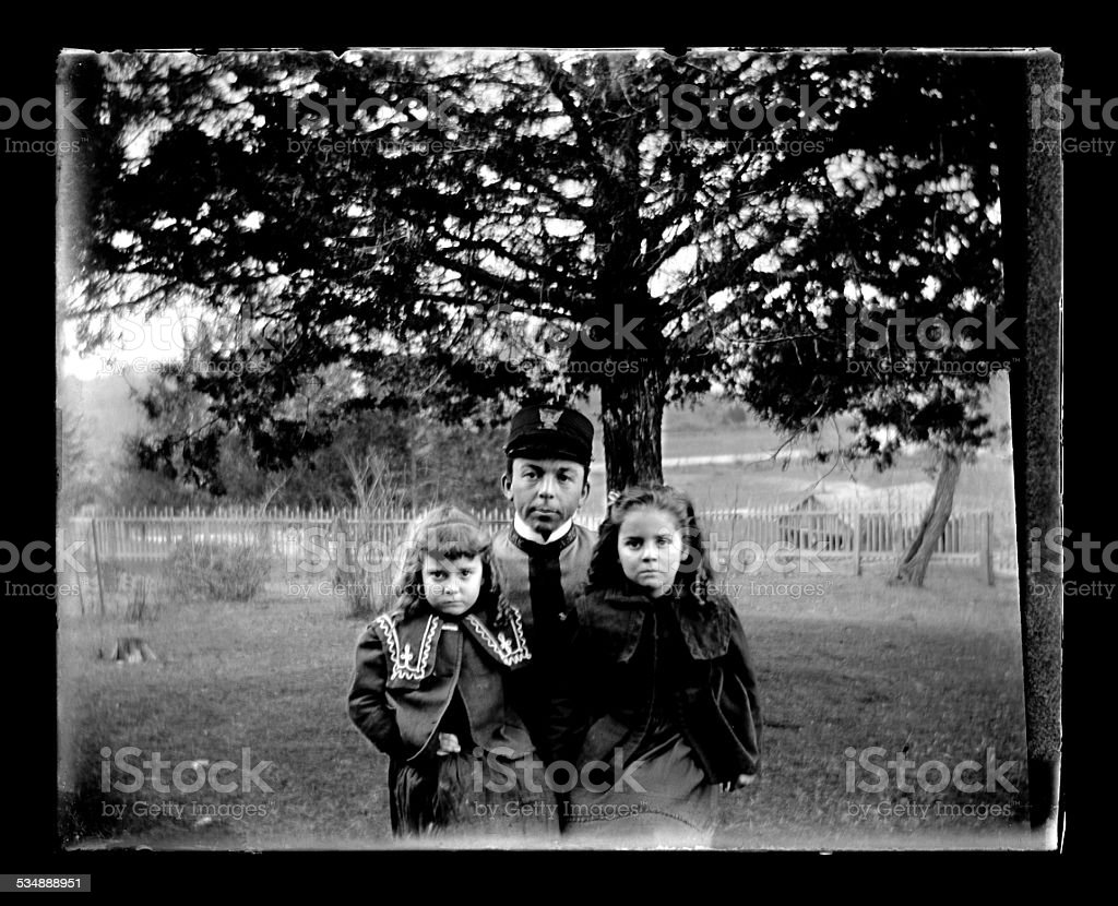 Military Cadet with Sisters stock photo