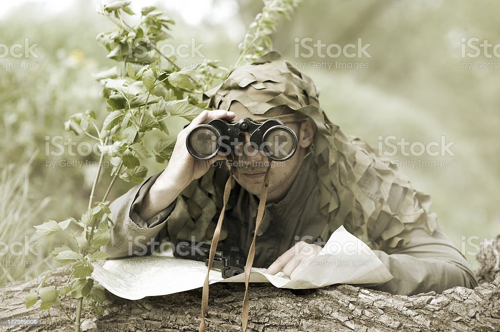 Military Camouflaged man stock photo
