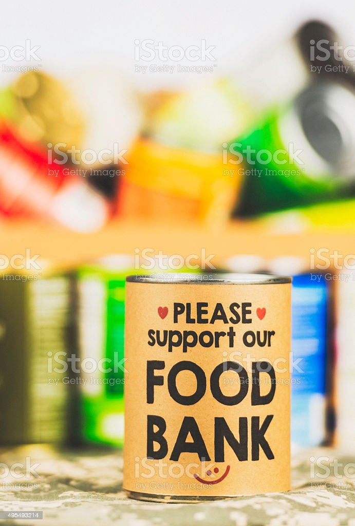 Please support our food bank. Canned food drive stock photo