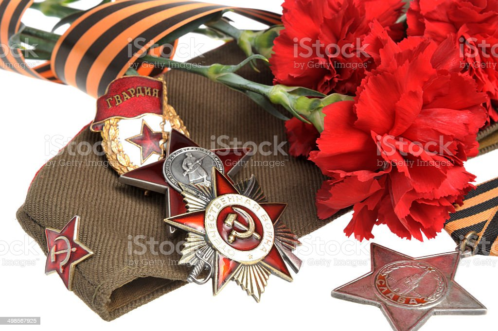 Military cap with red flowers, Saint George ribbon, military orders stock photo