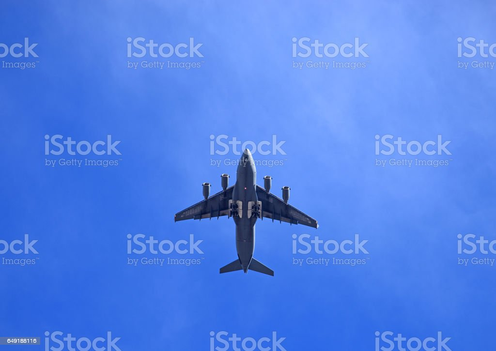 C-17 Military Cargo Transport Aircraft in blue sky stock photo