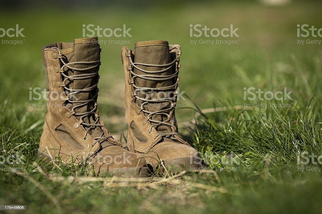 Military Combat Boots in a Field stock photo