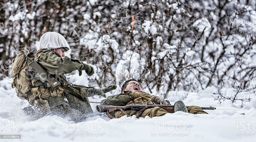 WWII Military Combat Medic Running To Help Triage Soldier Casualty stock photo