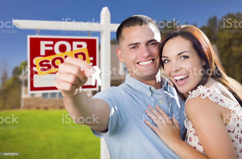 Military Couple In Front of Home, House Keys and Sign royalty-free stock photo