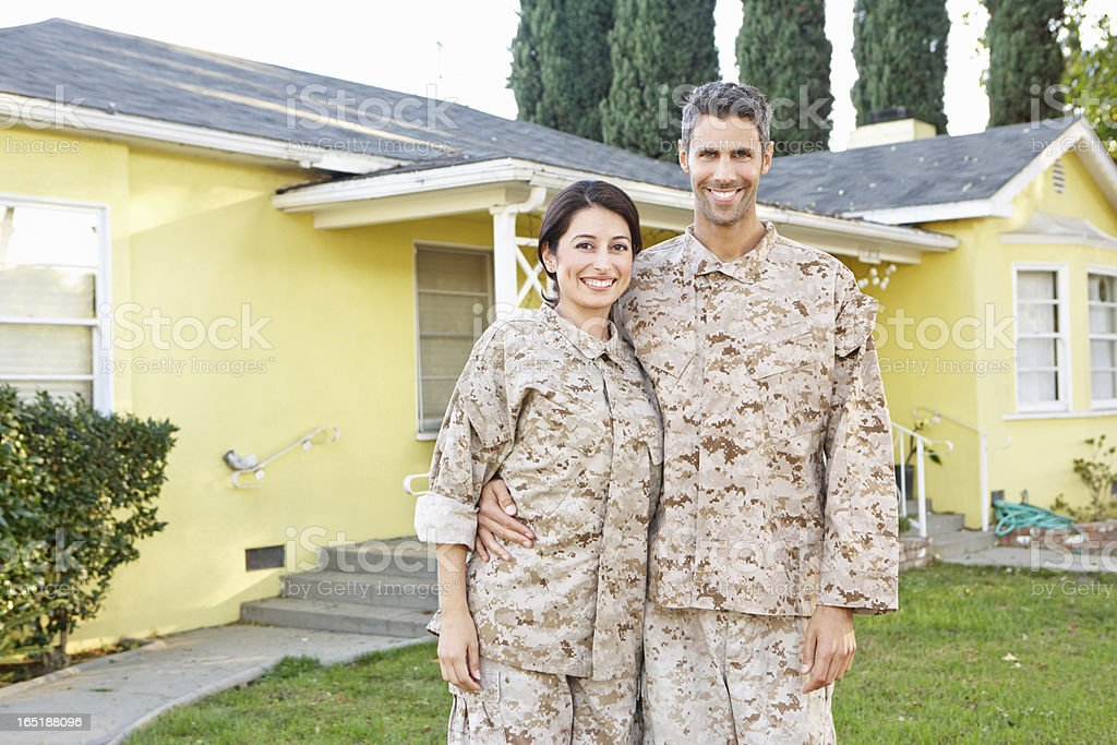 Military Couple In Uniform Standing Outside House stock photo