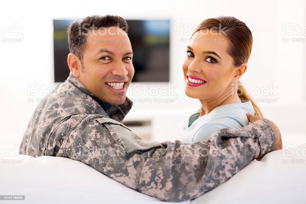 military couple looking back stock photo