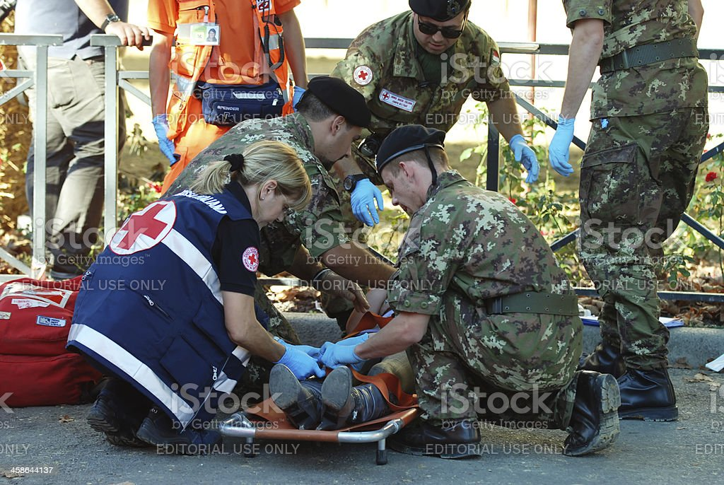 Military doctors and Paramedics Resuscitating royalty-free stock photo