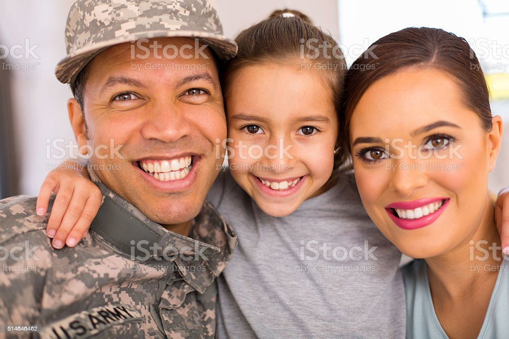 military family of three relaxing together stock photo
