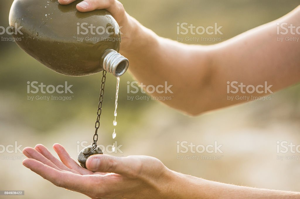 Military flask with water in the desert stock photo