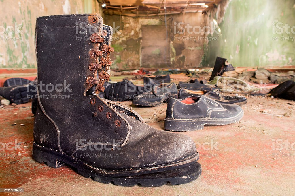 Military footwear in abandoned artillery. stock photo