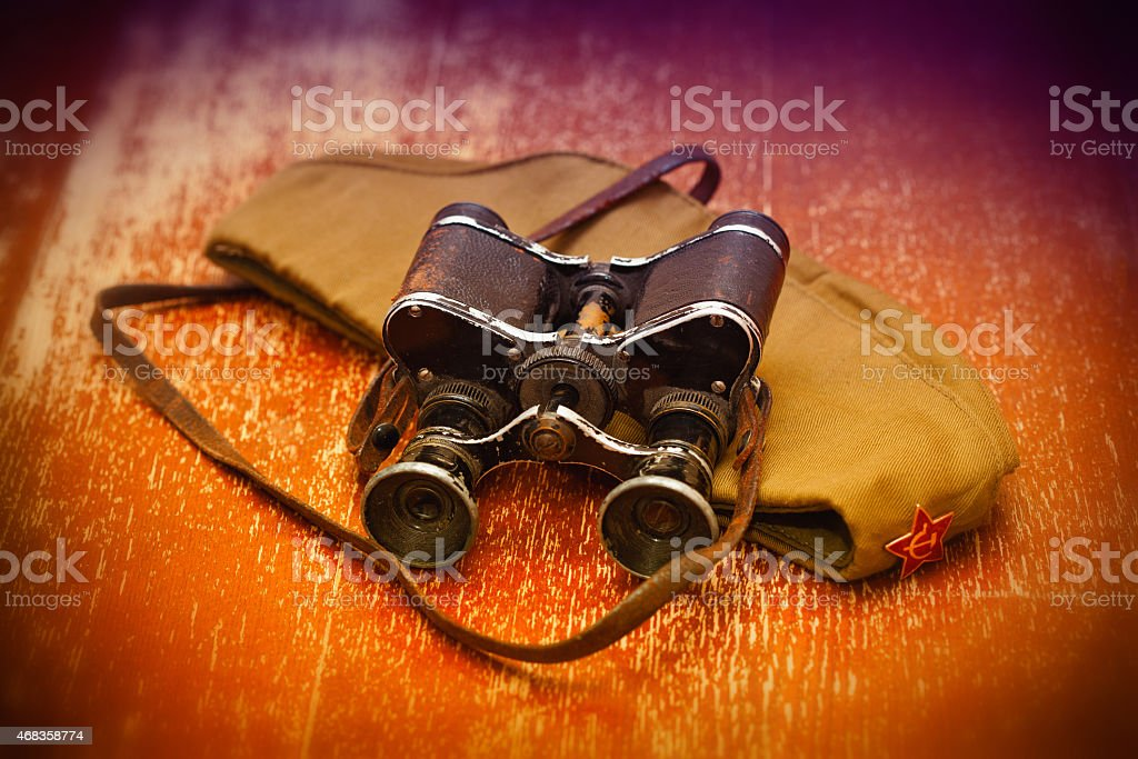 military garrison cap with a star, vintage military binoculars stock photo