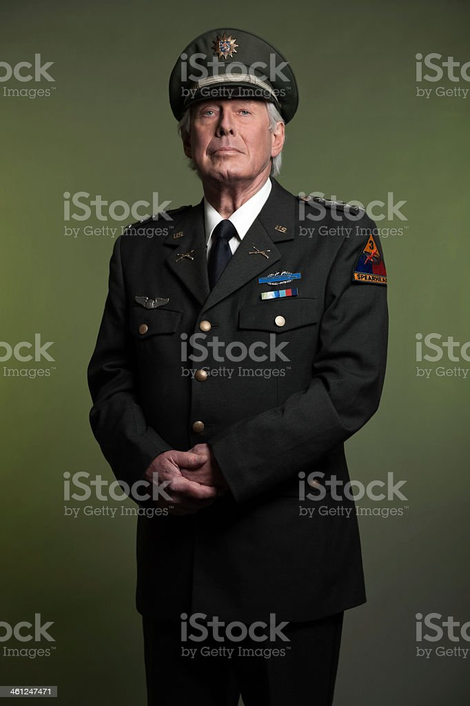 Military general standing proud in uniform stock photo