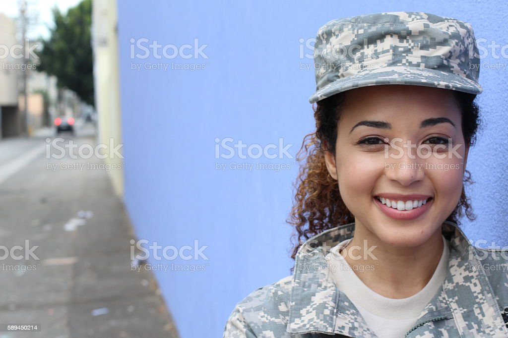 Military girl smiling outdoors with copyspace stock photo