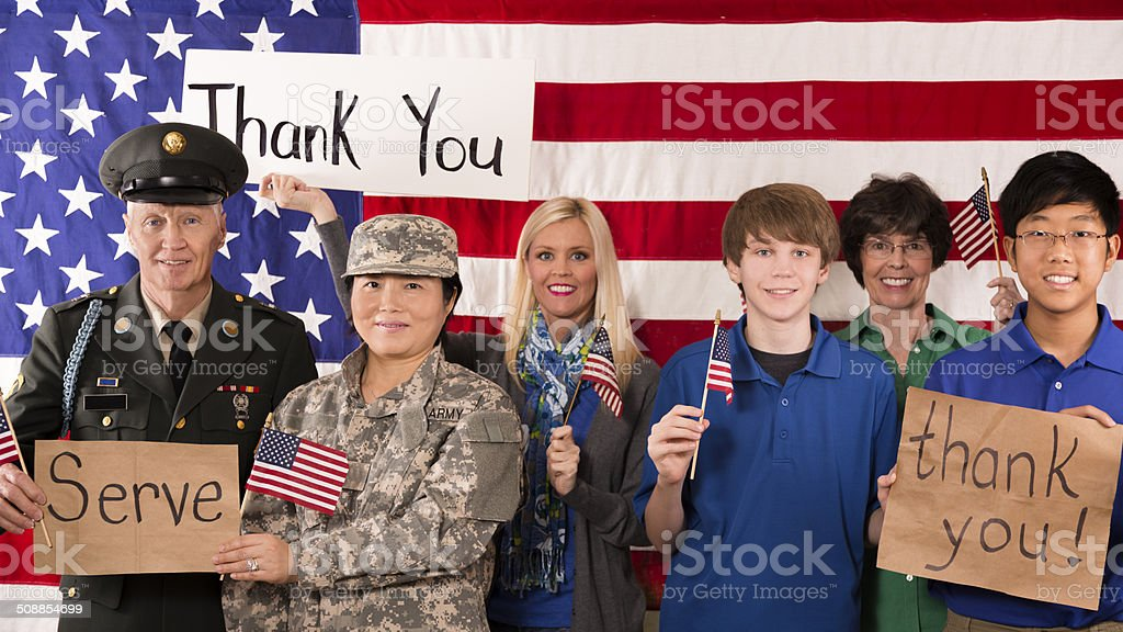 Military:  Group of people show appreciation for American veterans. stock photo